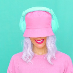 Smiling Dj Girl in stylish headphones and bucket hats. Minimal monochrome vanilla colours design trends