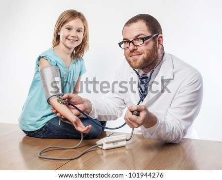 Smiling doctor and girl looking hopeful about routine check up blood pressure test and stethoscope