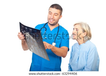 Smiling doctor and senior patient woman reviewing good results of magnetic resonance imaging isolated on white background