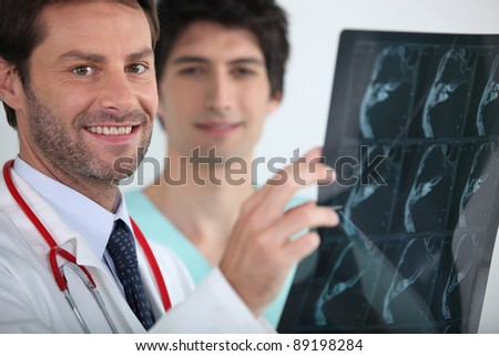 smiling doctor holding xrays