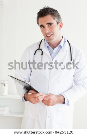 Smiling Doctor looking into the camera in a room