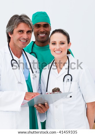 Smiling doctors and surgeon taking notes in the hospital