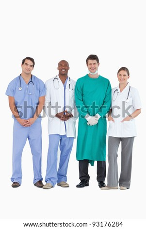 Smiling doctors standing together against a white background