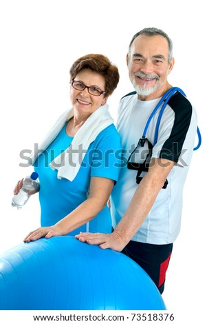 Smiling elderly couple working out in gym. Isolated on white