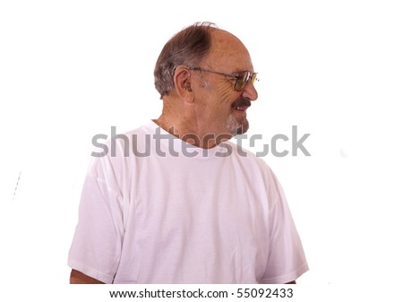 Smiling  Elderly man wearing his hearing aid.