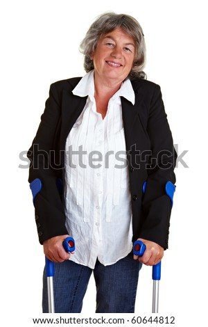 Smiling elderly woman walking with two crutches