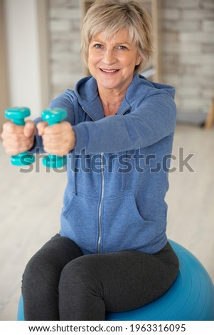 smiling elderly woman working out Stock photo ©