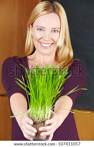 Smiling eldery woman with herbs in her hands