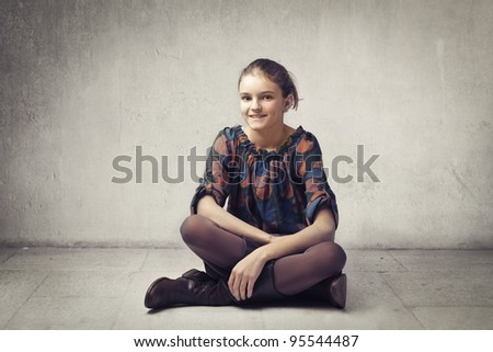 Smiling elegant teenage girl