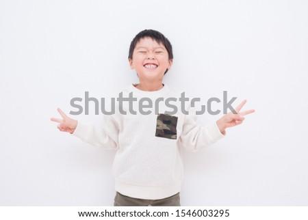 Smiling elementary school boy, piece, piece
