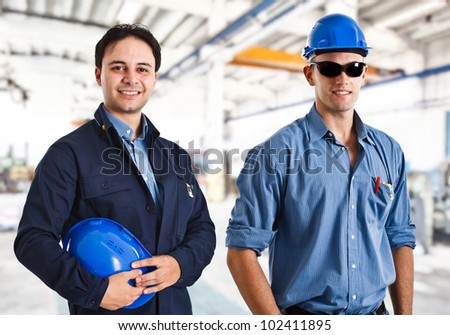 Smiling engineers at work