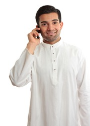 Smiling ethnic business man using phone - in traditional ethnic robe - Kurta - fastened with ruby buttons. The name Kurta is from Urdu & Hindi, & originally Persian (literally,