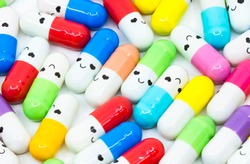 Smiling face colorful capsule medicine against rare diseases. Orphan drugs.