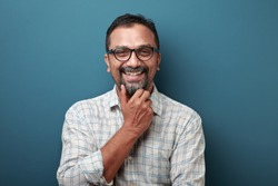 Smiling face of a man of Indian origin