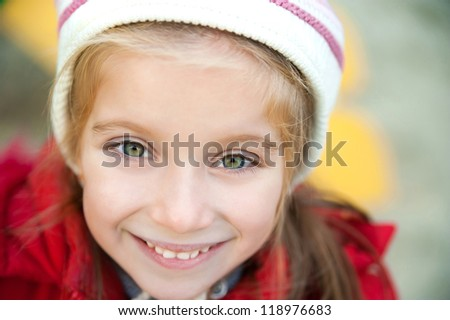 Smiling face of little girl closeup