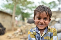 Smiling face portrait of a young child or young boy from rural part of India
