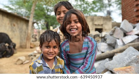 Smiling faces, young children smiling and having fun from rural part of India