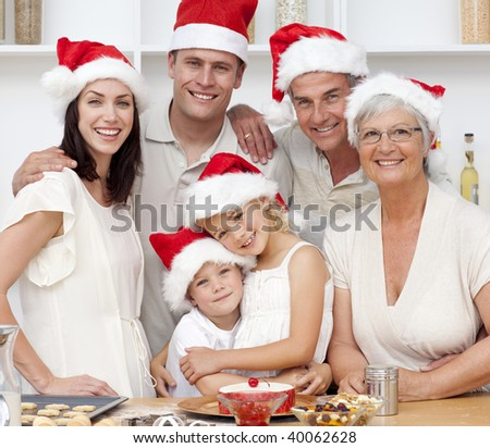 Smiling family baking in kitchen Christmas cakes in the kitchen