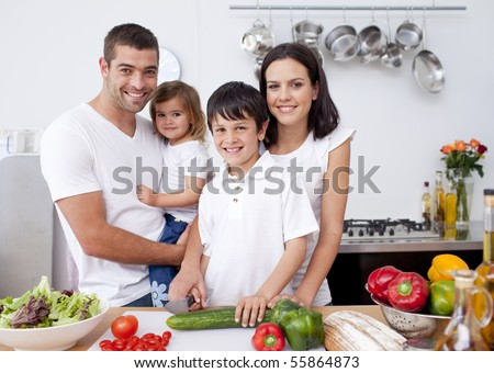 Smiling family cooking together in the kitchen