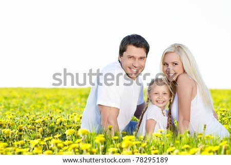 Smiling family in the lush field