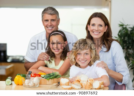 Smiling family making sandwiches together