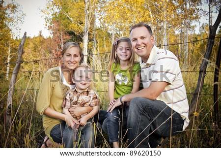 Smiling Family Outdoor Portrait - stock photo