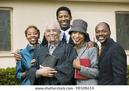 Smiling Family with Preacher