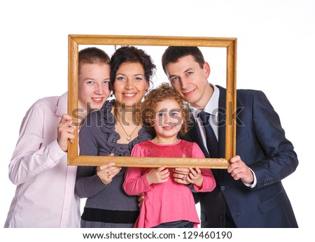 Smiling family with two kids looking through an frame. Isolated white background.