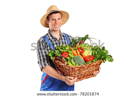 Smiling farmer holding a basket of vegetables isolated on white background - stock photo