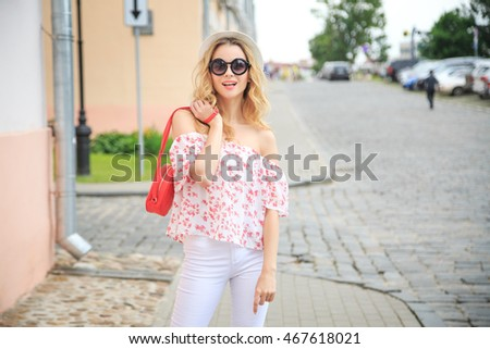 Smiling Fashion Woman in the Old Town Street. Happy Trendy Girl in Summer. Toned Photo with Copy Space. #467618021