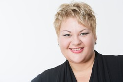 Smiling fat woman in black dress