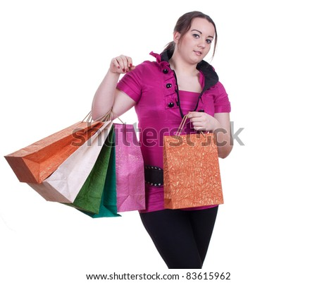 smiling fat young woman with shopping bags