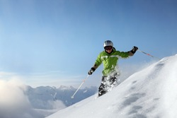 Smiling femal skiier with view to mountains in powder snow