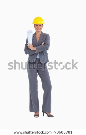Smiling female architect with folded arms against a white background