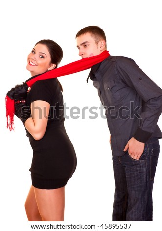 smiling female drag her boyfriend with her scarf