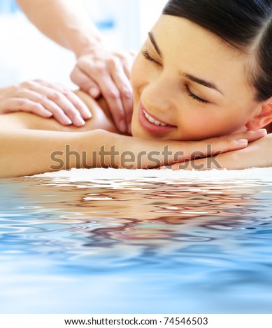 Smiling female during luxurious procedure of massage