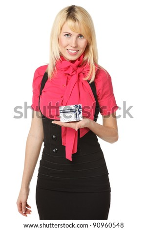 Smiling female holding small gift box, isolated on white background