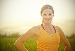 Smiling Female Jogger at Sunset (intentional sun glare)