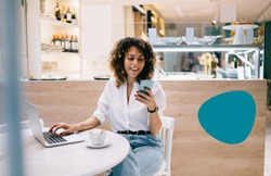 Smiling female manager using digital cellphone gadget for checking delivery service via online app connecting to 4g wireless in coffee shop, cheerful freelancer sending sms message via mobile phone