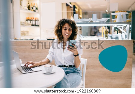 Smiling female manager using digital cellphone gadget for checking delivery service via online app connecting to 4g wireless in coffee shop, cheerful freelancer sending sms message via mobile phone Photo stock ©