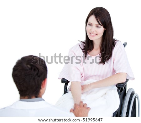 Smiling female patient in a wheelchair interacting with her doctor against a white background