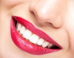 Smiling female red lips and healthy white teeth closeup shot with mouth open