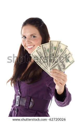 Smiling female with pile of dollar banknotes (isolated) (focus on hand)