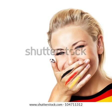 Smiling football fan, closeup on face, female covering mouth with painted in flag colors hand, woman expressing emotions of joy, German team supporter, girl watching game, isolated on white background