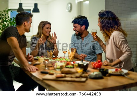 Smiling friends at dinner party