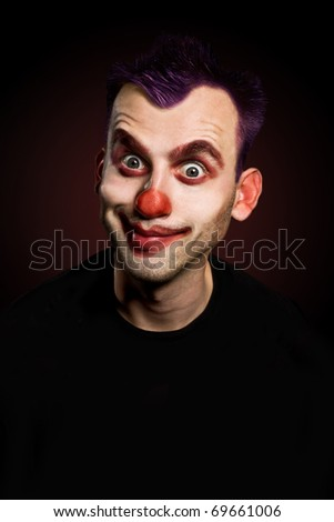 smiling funny male clown over gradient background