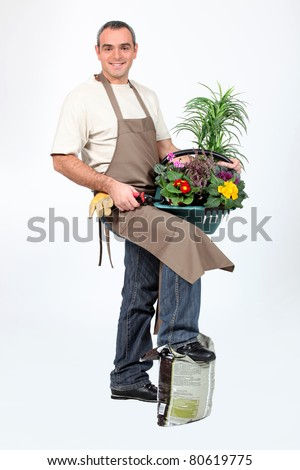 Smiling gardener on white background