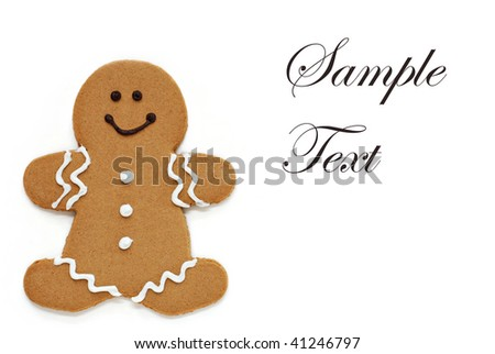 Smiling gingerbread man on white background with copy space.