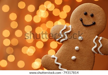 Smiling gingerbread man with lights in background.  Macro with shallow dof.
