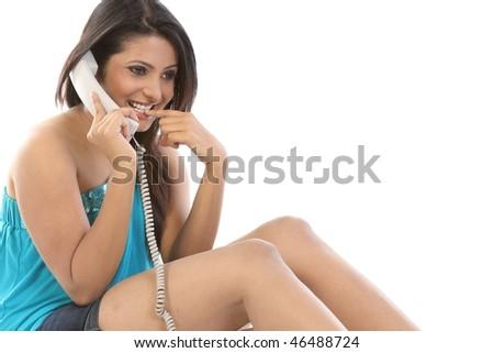 Smiling girl chatting in the phone